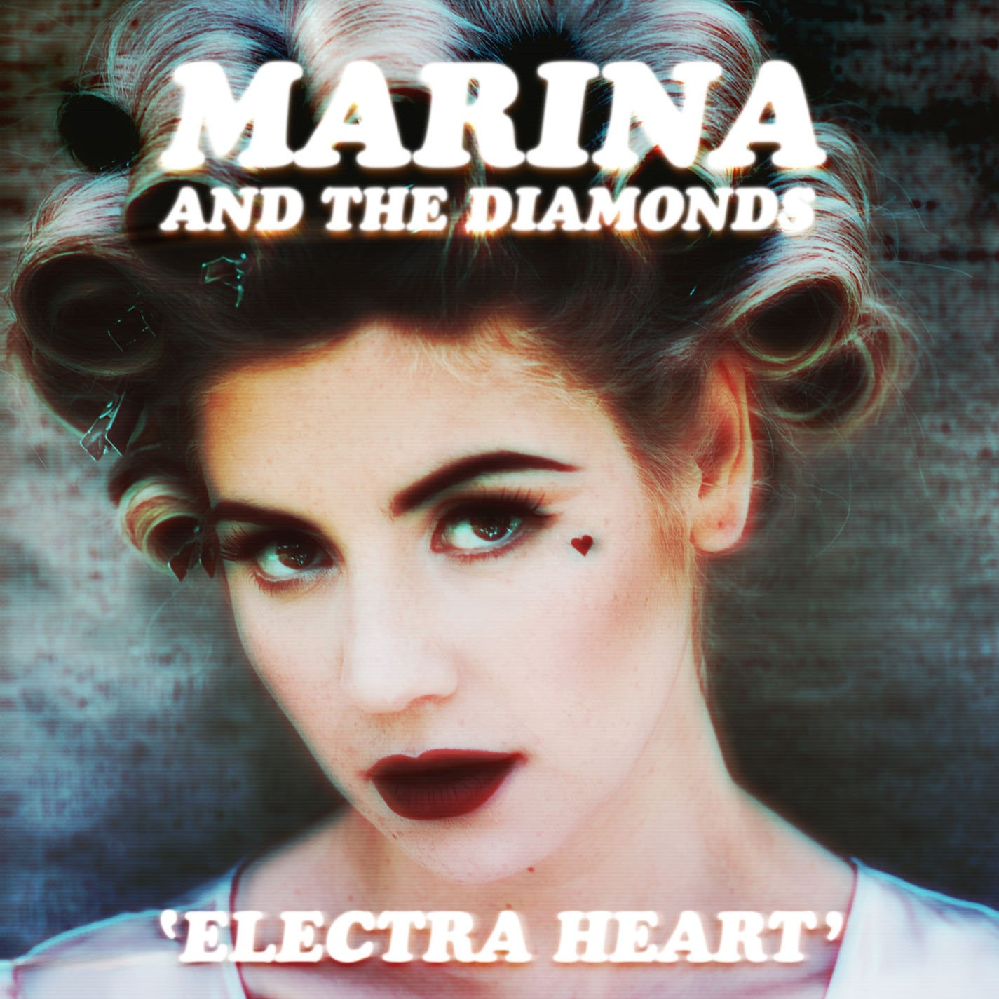An image of the cover of the album 'Electra Heart', showing a young woman wearing hair rollers, with a small heart drawn with makeup just below her left eye, as if a tear.